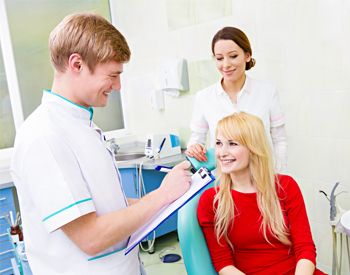 Smiling woman talking to dentist