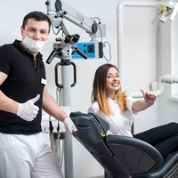 Woman happy in dental chair at Castle Hills dentist.