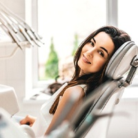 Woman sitting in dental chair during routine appointment.