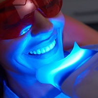 close up of woman getting in-office teeth whitening