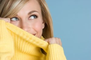 woman hiding smile embarrassed