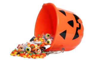 Halloween pumpkin bucket overflowing with candy