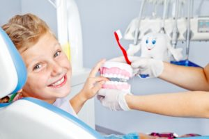 Girl using children's dental insurance coverage.